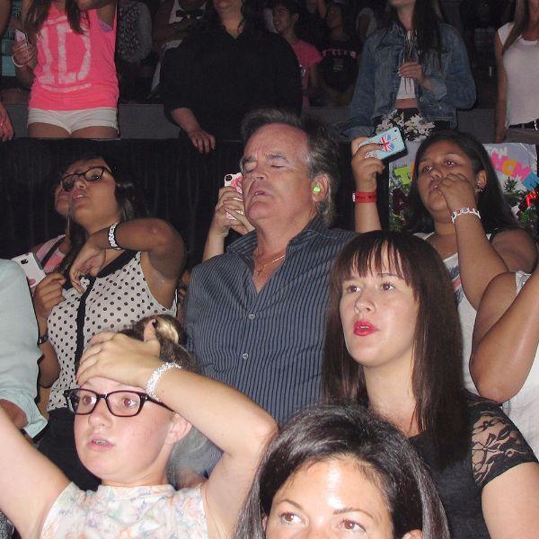 dad sleeping at concert